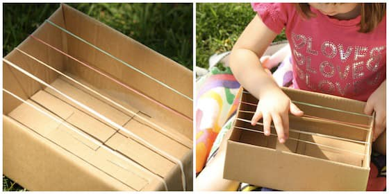 A guitar made from a cardboard box and elastics.