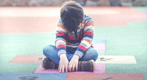 boy upset at school
