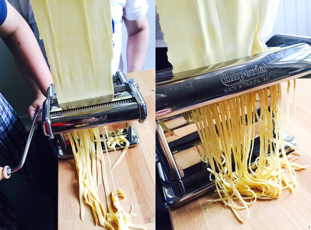Fresh pasta coming out of a pasta machine.