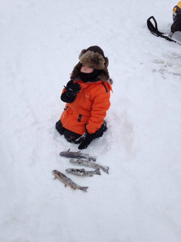 A 5 year old ice fishing.