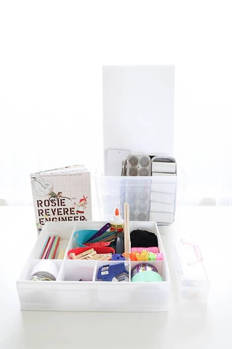 Inventing kit include a book, glue, tape, glue gun and material.