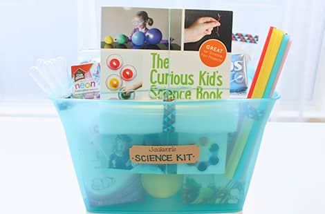 Science kit full of books and tools to use for experiments.