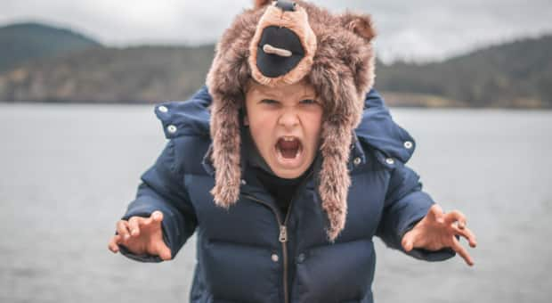 An independent child dresses like a bear and growls freely