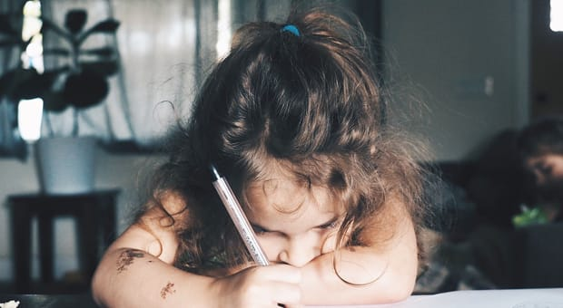 a child fills out a school book order