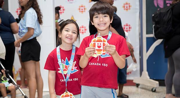 Kids holding CBC Kids gem