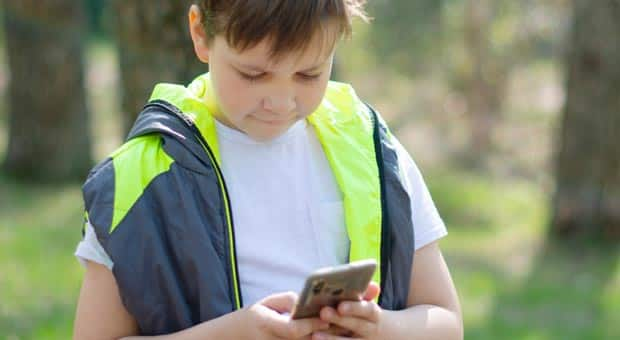 young boy on phone
