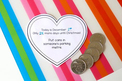 The day's activity is to put coins in someone's parking metre, and there are coins lying next to the heart on the table.