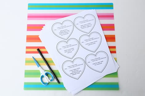 The printed kindness activities, plus a pen and a pair of scissors.