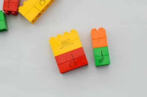 A stack of larger blocks beside a stack of smaller blocks representing rests with their note equivalent
