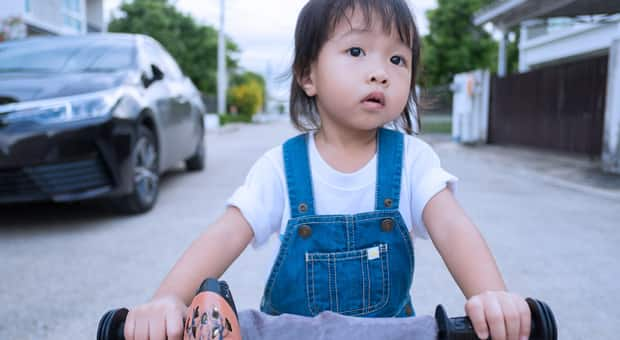 A young girl riding her bike