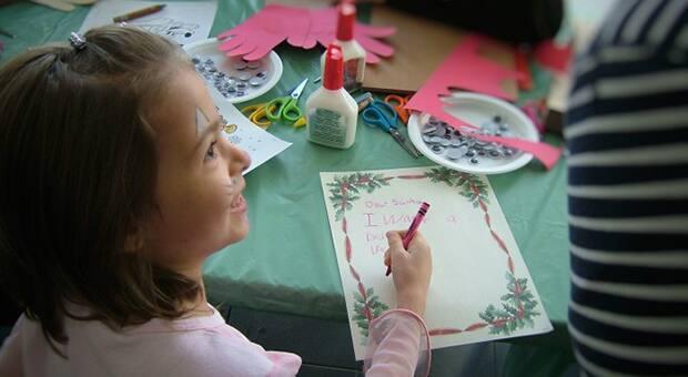 Little girl writes a letter to Santa