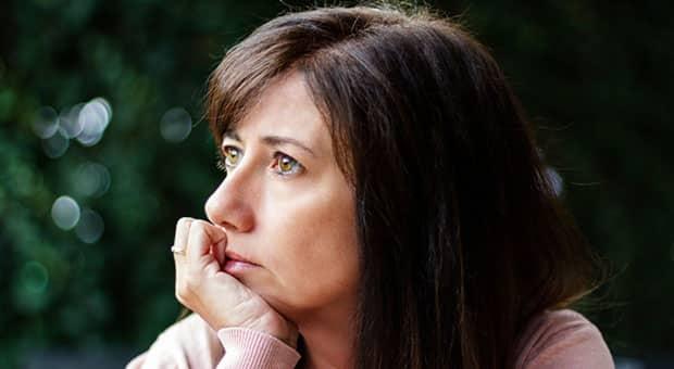 Woman looks reflective