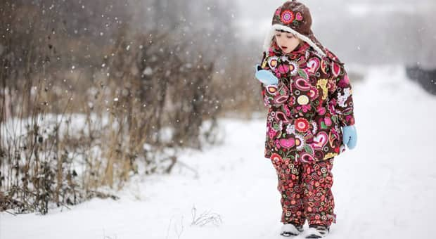 a young girl takes a nature walk for march break