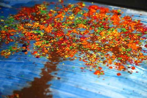 The wax has melted and spread out to make a beautiful, colourful fall tree!