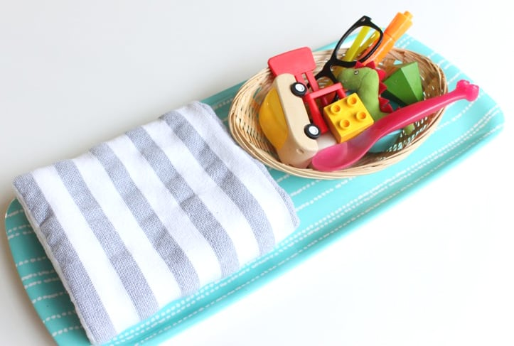 Memory game supplies: a tray, a tea towel and small objects from around the house.