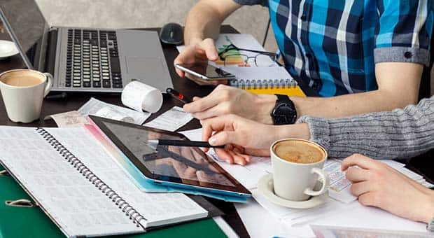 People busy at work at a table