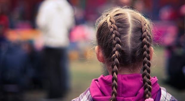 Young tween girl with braids.