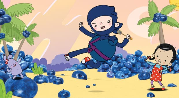 The lead character, Ollie, dressed as a blueberry and performing a ninja kick.