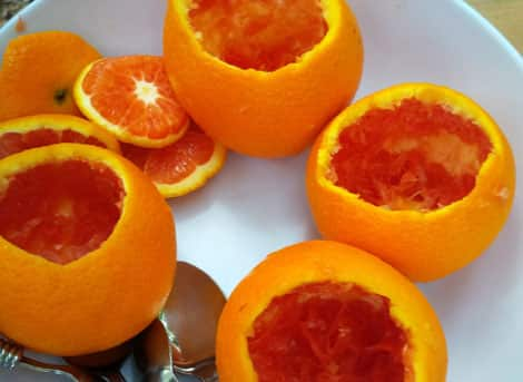 A plate full of hollowed-out orange peels.