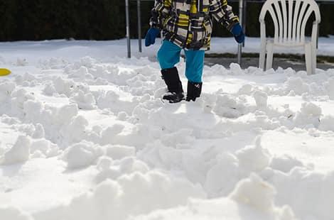 Child walks through snow maze.