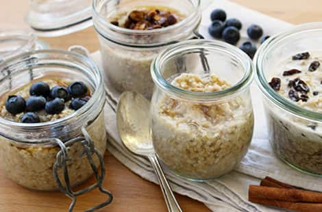 Different batches of overnight oats in mason jars.
