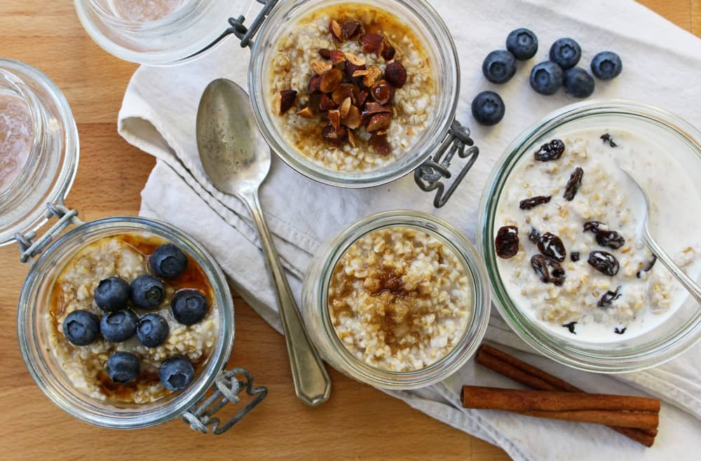 Jars of overnight oats with toppings.