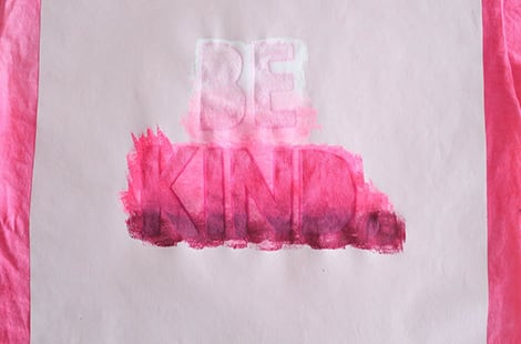Painting on pink t-shirt.