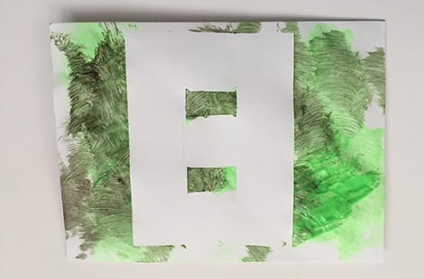 Peeled tape shows a white number 8 popping from green paint.