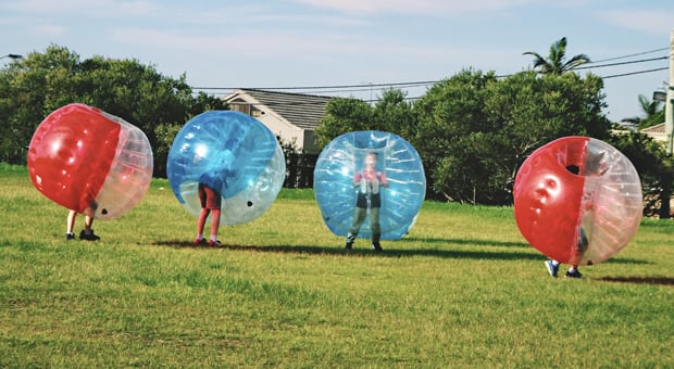 kids playing creatively outside in their own bubbles