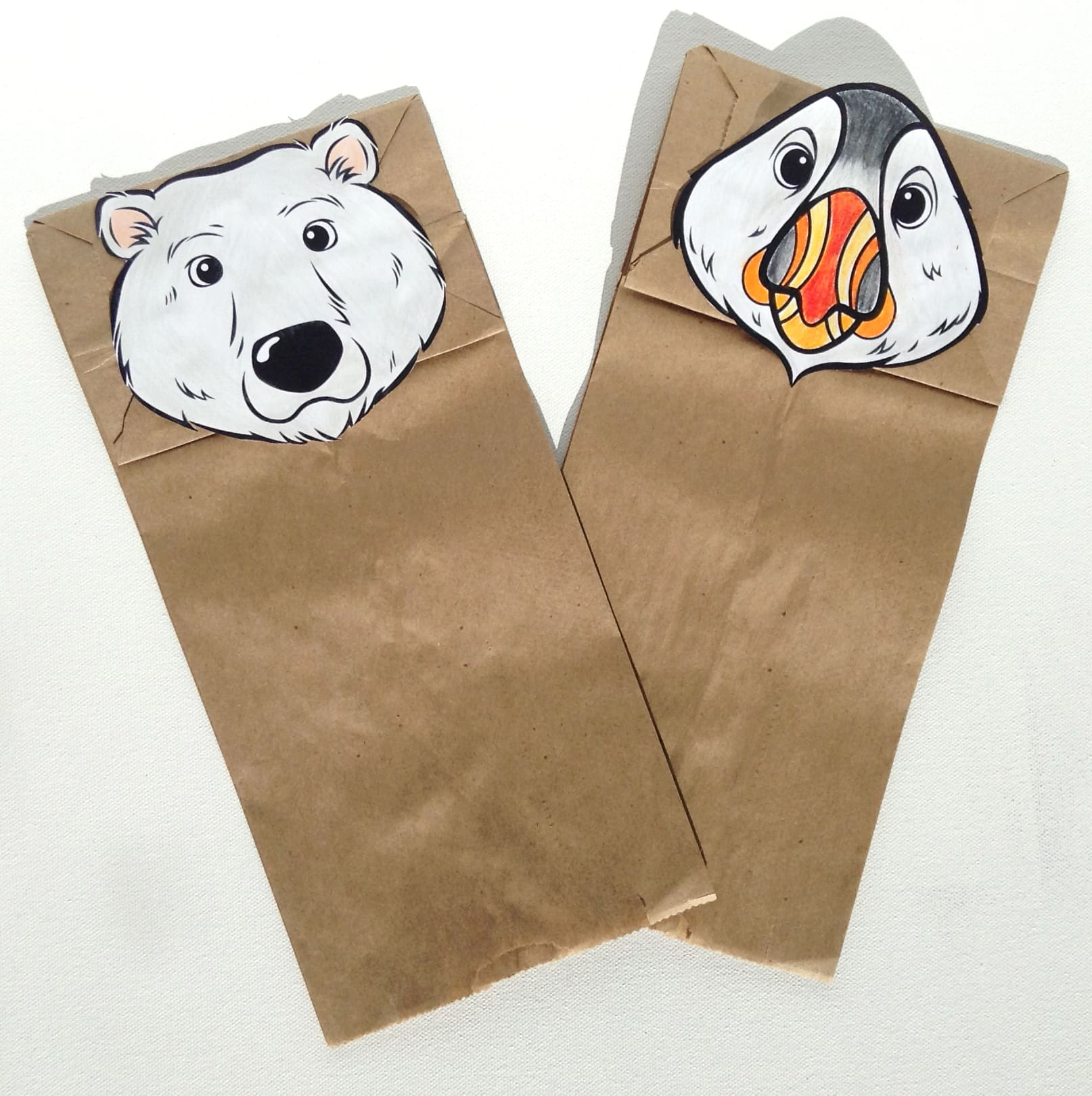 A paper polar bear and puffin head glued on to a paper bag