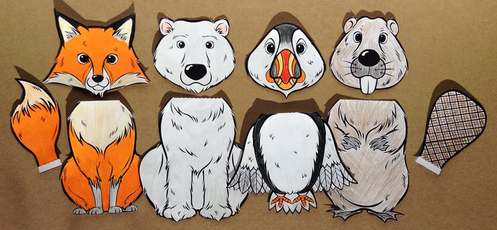 A fox, polar bear, puffin and beaver, coloured in a cut out.