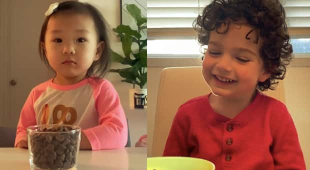 two kids try to pass the patience challenge with some help from their parents