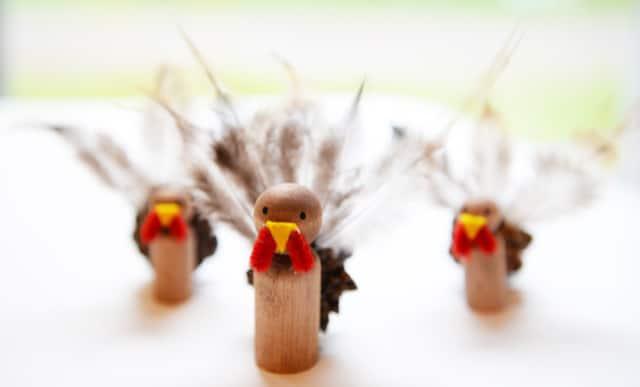 3 peg doll and pine cone turkeys.