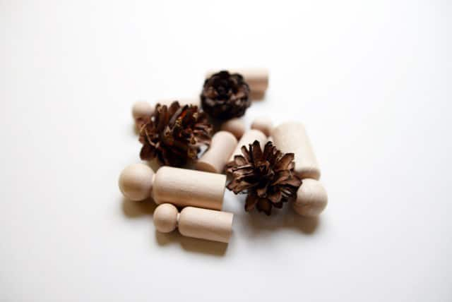 A pile of pine cones and peg dolls.