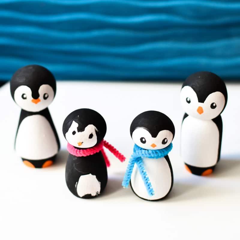 4 penguin peg dolls.