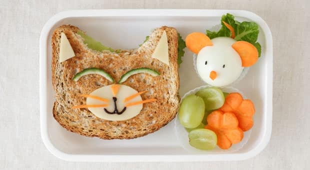 A pinterest-y lunch: a sandwich cut into a cat shape, and an egg that looks like a little mouse with carrot ears.