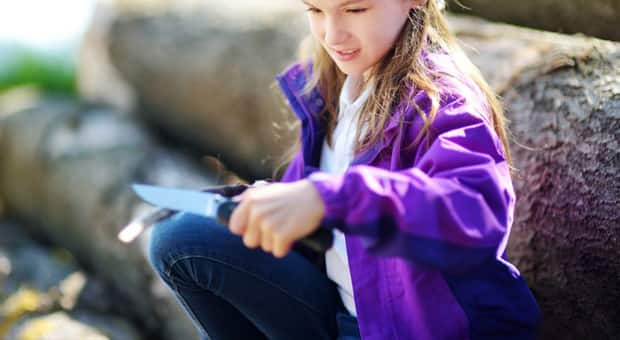 young girl holding pocket knife