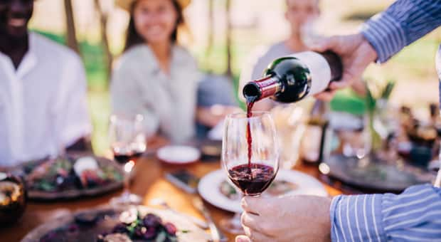 A group of friends drink at a winery