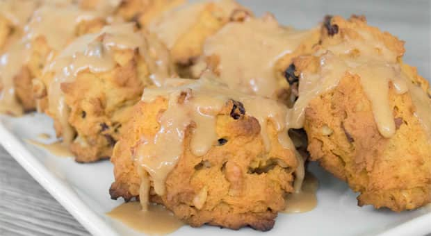 A plate of pumpkin-spice cookies drizzled with brown-sugar icing.