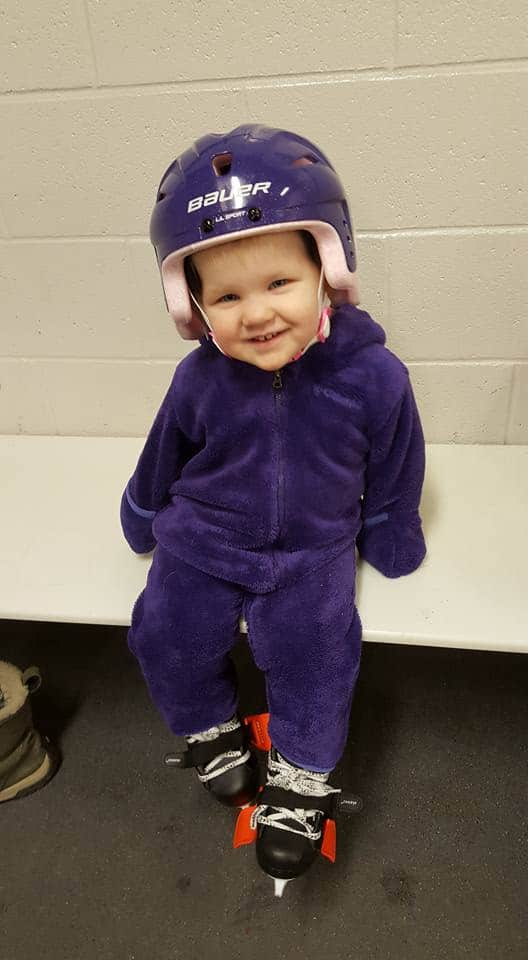 A toddler about to go skating.