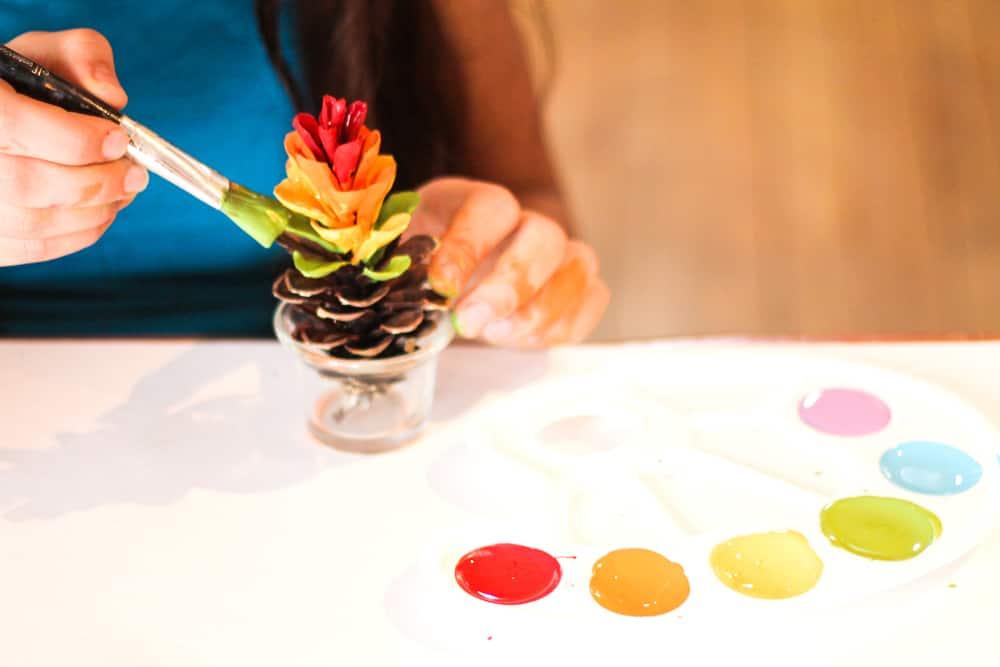 painting rainbow pinecones