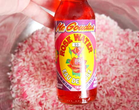 A bottle of red-coloured rose water, used to make pink rice.