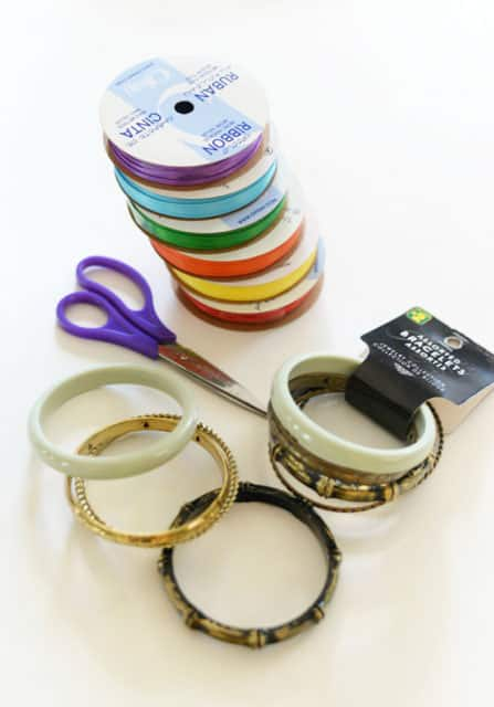 Bracelets, scissors and different colours of ribbon.