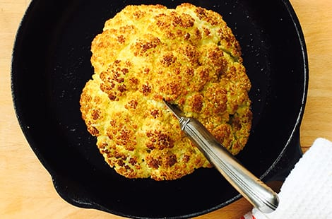 Roasted cauliflower in a cast iron pan.