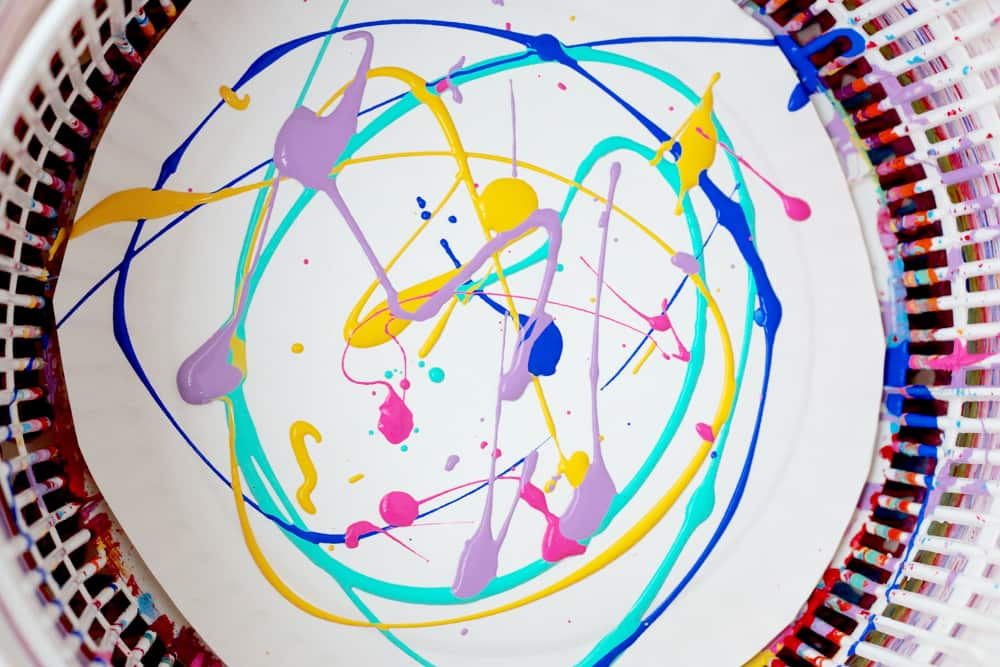 Paint splattered on a paper plate.