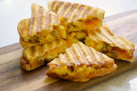 Grilled cheese sandwiches filled with mac and cheese and meatballs.