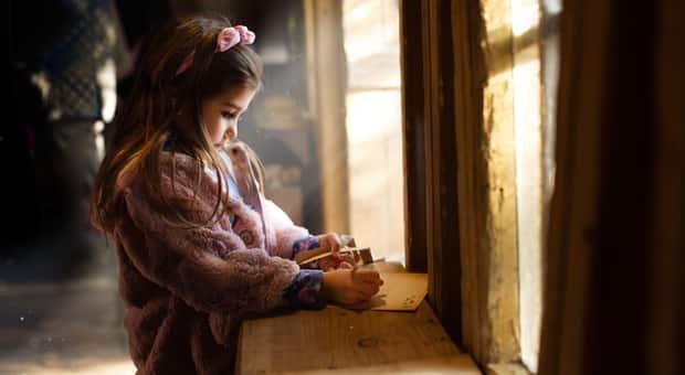 little girl writes letter to Santa