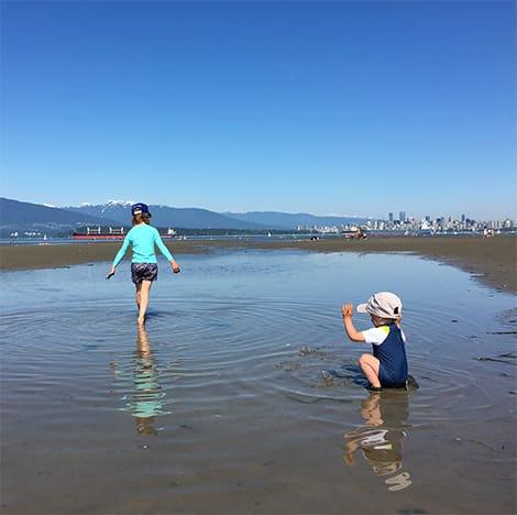 Kids playing on beach.