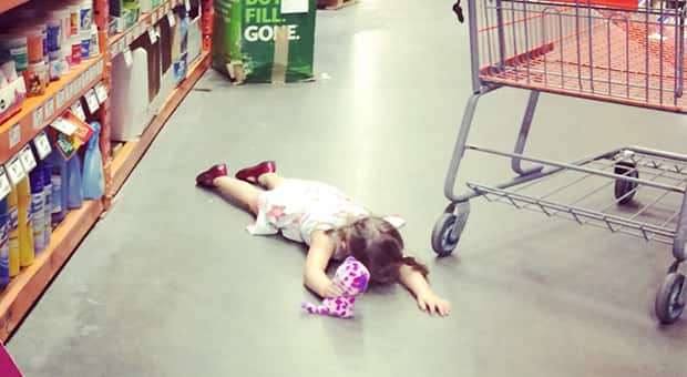 Child lays face down in shopping aisle