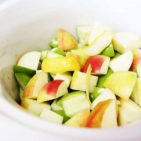 a close up photo of the chunks of apple in the slow cooker